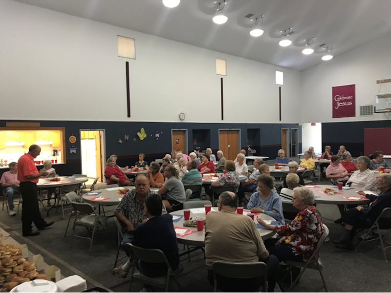 One of our senior dinners with Pastor Mike welcoming our visitors. We usually averaged 50 people at these meals. This has been well received in the community.
